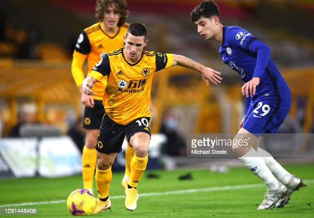 Daniel Podence of Wolves is challenged by Kai Havertz of Chelsea during the Premier League match between Wolverhampton Wanderers and Chelsea at...