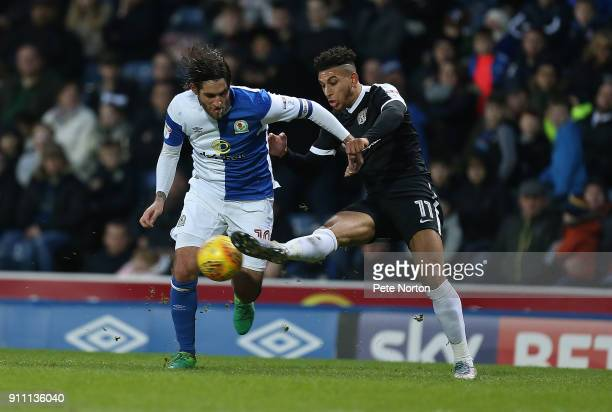 Daniel Powell of Northampton Town contests the ball with Danny Graham of Blackburn Rovers during the Sky Bet League One match between Blackburn...