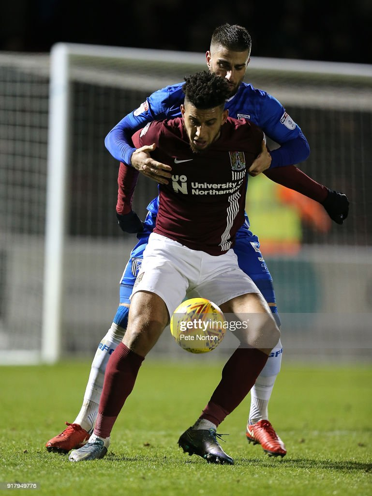 Daniel Powell of Northampton Town looks to control the ball under pressure from Max Ehmer of Gillingham during the Sky Bet League One match between Northampton Town and Gillingham at Sixfields on February 13, 2018 in Northampton, England.