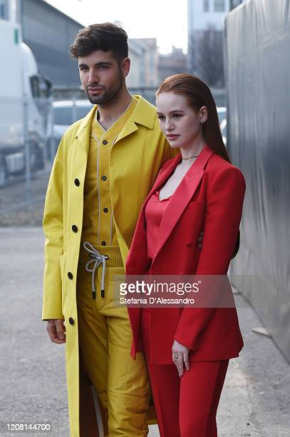 Daniel Preda and Madelaine Petsch arrive at the Boss fashion show on February 23 2020 in Milan Italy
