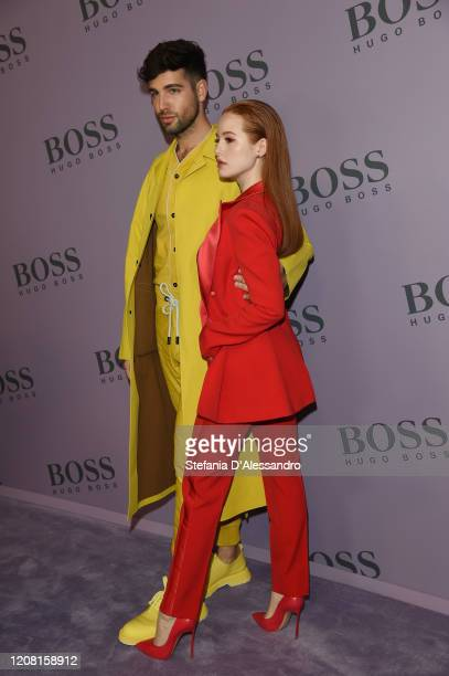 Daniel Preda and Madelaine Petsch attend the Boss fashion show on February 23 2020 in Milan Italy