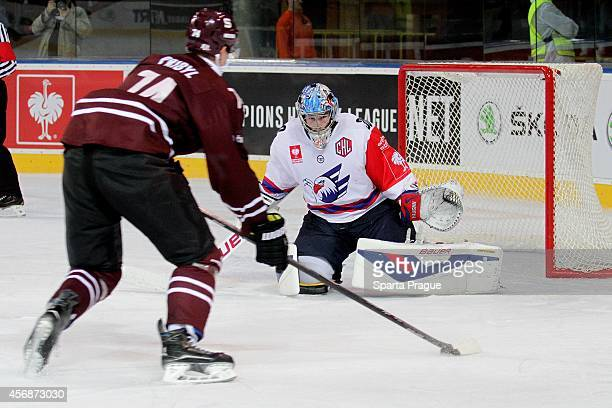 Daniel Pribyl of HC Sparta Prague attempts to score against Youri Ziffzer of Adler Mannheim during the Champions Hockey League group stage game...