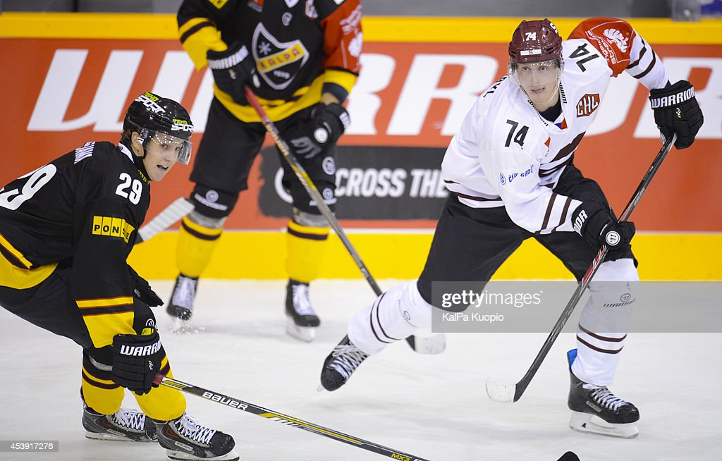 Daniel Pribyl passes the puck during the Champions Hockey League game between KalPa Kuopio and Sparta Prague at Data Group Areena on August 21, 2014 in Kuopio, Finland.