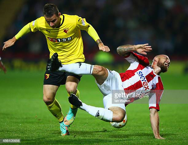 Daniel Pudil of Watford and Alan McCormack of Brentford battle for the ball during the Sky Bet Championship match between Watford and Brentford at...