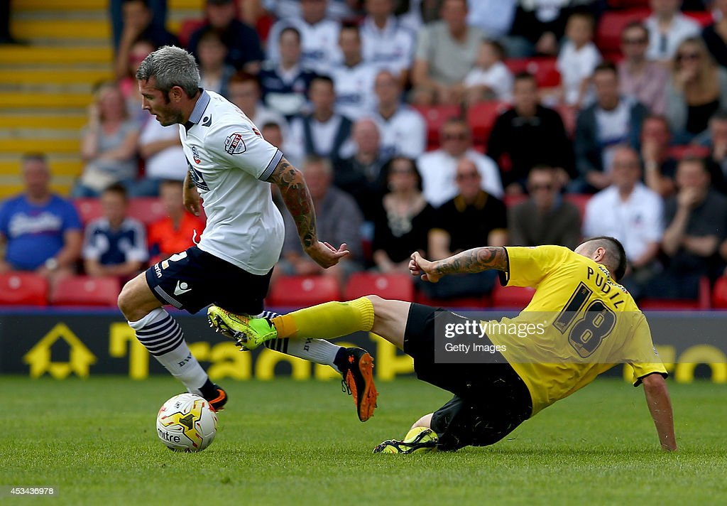 Daniel Pudil of Watford tackles Kevin McNaughton of Bolton Wanderers during the Sky Bet Championship match between Watford and Bolton Wanderers at Vicarage Road on August 9, 2014 in Watford, England.