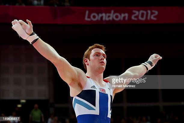 Daniel Purvis of Great Britain dismounts the rings in the Artistic Gymnastics Men's Individual AllAround final on Day 5 of the London 2012 Olympic...