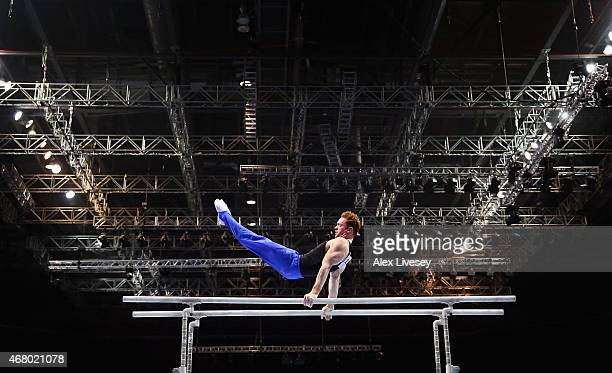 Daniel Purvis of Southport YMCA competes on the parallel bars during the Men's Artistic Masters on day three of the Mens Womens Artistic British...