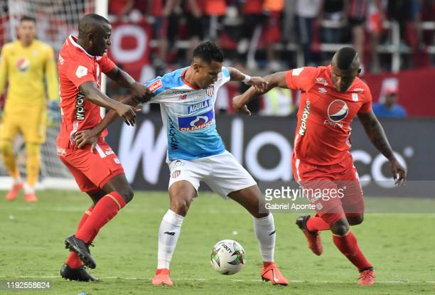 Daniel Quiñones and Marlon Torres of America struggle the ball with James Sanchez of Junior during the second leg final match of the Torneo Clausura...