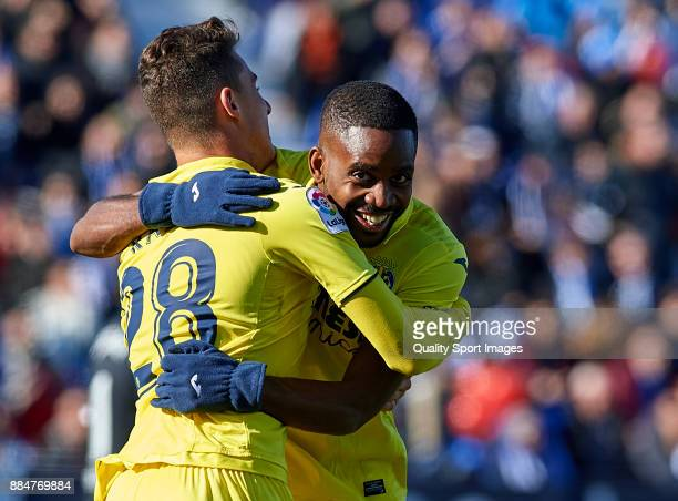 Daniel Raba of Villarreal celebrates scoring his team's first goal with his teammate Cedric Bakambu during the La Liga match between Leganes and...