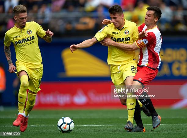 Daniel Raba of Villarreal competes for the ball with Alex Granell of Girona during the La Liga match between Villarreal and Girona at Estadio de La...