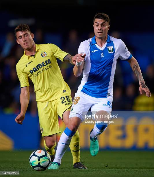 Daniel Raba of Villarreal competes for the ball with Pablo Insua Blanco of Leganes during the La Liga match between Villarreal and Leganes at Estadio...