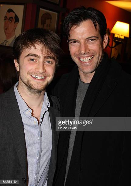 Daniel Radcliffe and costar Lorenzo Pisoni pose as Radcliffe receives his portrait celebrating his performance in Equus on Broadway portrait at...