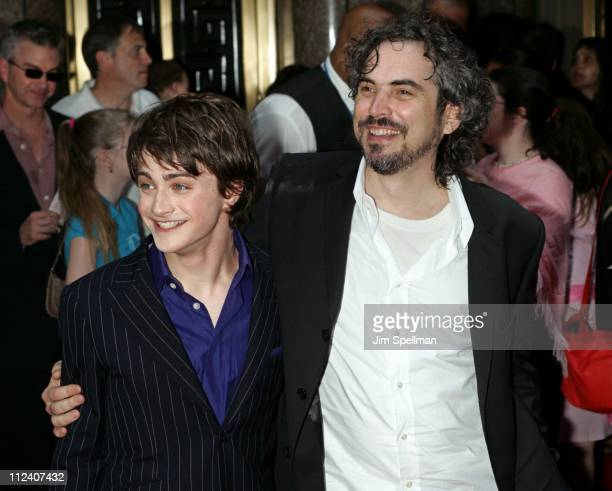 Daniel Radcliffe and director Alfonso Cuaron during 'Harry Potter and the Prisoner of Azkaban' New York Premiere Arrivals at Radio City Music Hall in...