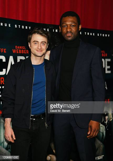 """Daniel Radcliffe and Francis Annan attend the gala screening of """"Escape From Pretoria"""" at the Curzon Soho on February 16, 2020 in London, England."""