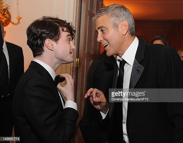 Daniel Radcliffe and George Clooney attend the Bloomberg Vanity Fair cocktail reception following the 2012 White House Correspondents' Association...