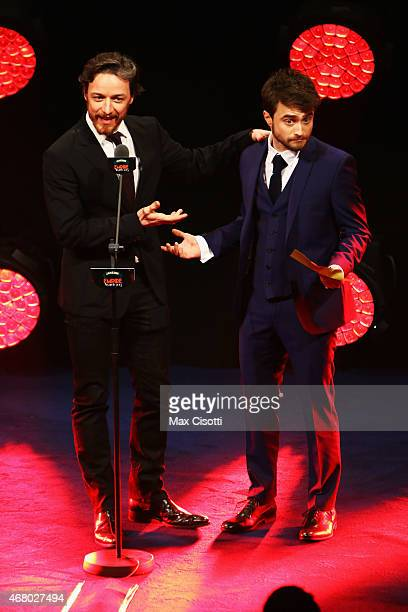 Daniel Radcliffe and James McAvoy present on stage during the Jameson Empire Awards 2015 at the Grosvenor House Hotel on March 29 2015 in London...