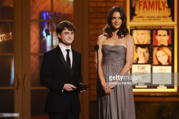 Daniel Radcliffe and Katie Holmes present onstage during the 64th Annual Tony Awards at Radio City Music Hall on June 13, 2010 in New York City.
