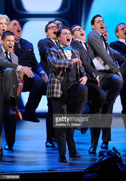 Daniel Radcliffe and the cast of 'How To Succeed in Business Without Really Trying' perform on stage during the 65th Annual Tony Awards at the Beacon...