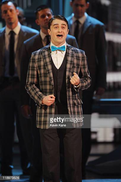 Daniel Radcliffe and the cast of 'How To Succeed in Business Without Really Trying' perform on stagee during the 65th Annual Tony Awards at the...