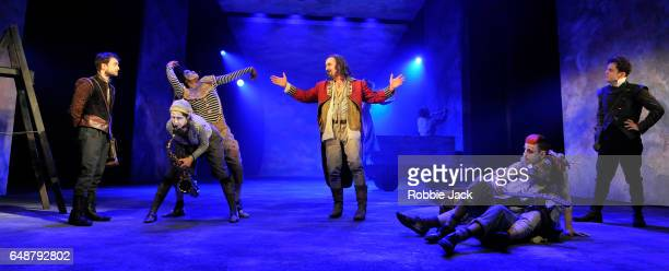 Daniel Radcliffe as RosencrantzDavid Haig as The Player and Joshua McGuire as Guildenstern with artists of the company in Tom Stoppard's Rosencrantz...