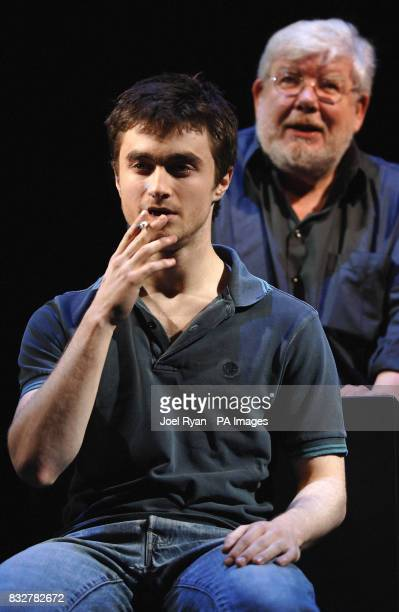 Daniel Radcliffe drags on a cigarette alongside Richard Griffiths during a photocall for the theatre production of Equus at the Gielgud Theatre...