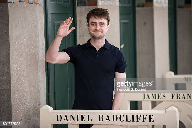 Daniel Radcliffe poses for photographers after unveiled his dedicated beach locker room during the 42nd Deauville American Film Festival on September...