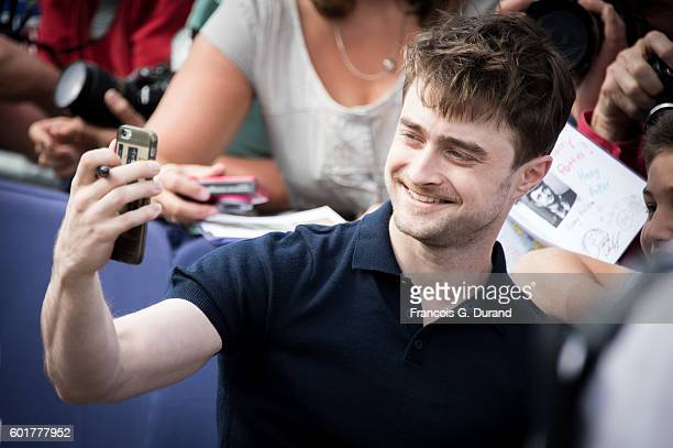 Daniel Radcliffe signs autographs after he unveiled his dedicated beach locker room during the 42nd Deauville American Film Festival on September 10...