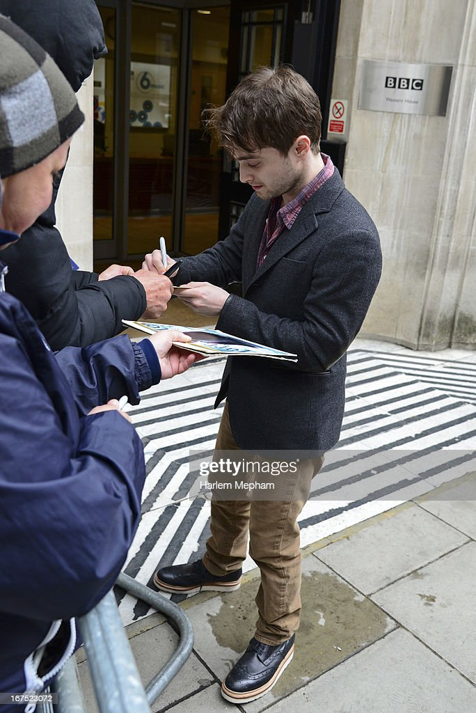 Daniel Radcliffe signs autographs at BBC Radio One on April 26, 2013 in London, England.