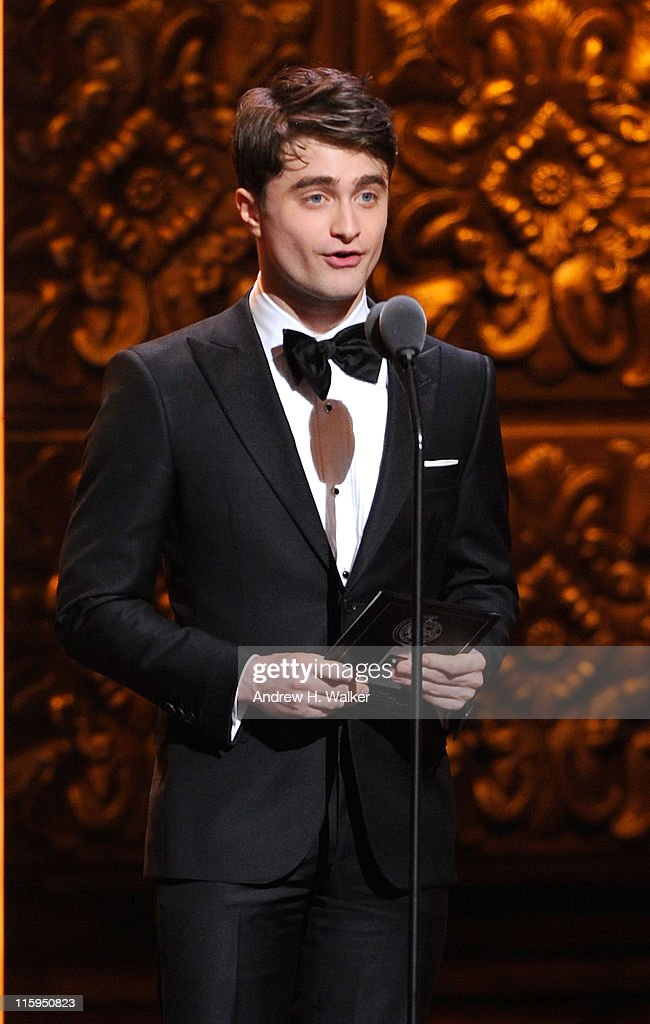 Daniel Radcliffe speaks on stage during the 65th Annual Tony Awards at the Beacon Theatre on June 12, 2011 in New York City.