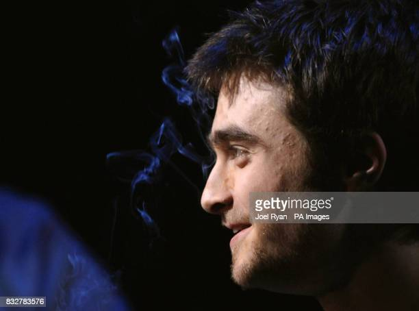 Daniel Radcliffe with smoke from his cigarette in front of his eyes during a photocall for the theatre production of Equus at the Gielgud Theatre...