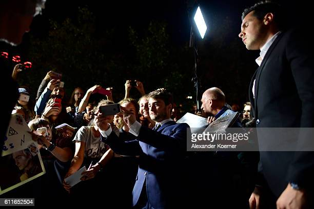 Daniel Radcliffe writes autographs and takes selfies with fans as he attends the 'Imperium' premiere during the 12th Zurich Film Festival on...
