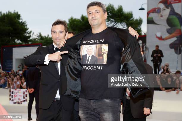 Daniel Renne and Luciano Silighini on the red carpet wearing a 'Weinstein is innocent' tshirt ahead of the 'Suspiria' screening during the 75th...