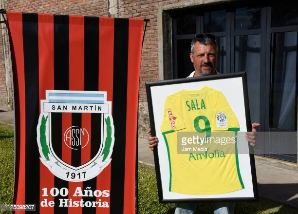 Daniel Ribero President of San Martin Club poses with Sala's framed jersey at the club where Emiliano Sala's wake will take place on February 15 2019...
