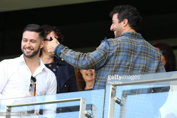 Daniel Ricciardo acknowledges a spectator during the AFL Prelimary Final match between the West Coast Eagles and the Melbourne Demons on September 22...