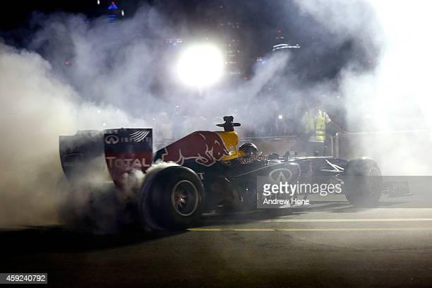 Daniel Ricciardo and Sebastian Vettel drive during an Infiniti Red Bull Racing show run in Dubai ahead of the Abu Dhabi Formula One Grand Prix at Yas...