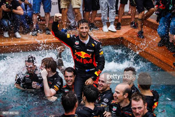 Daniel Ricciardo from Australia with Aston Martin Red Bull Tag Heuer RB14 celebrating his victory with the team at the swimming pool during the Race...