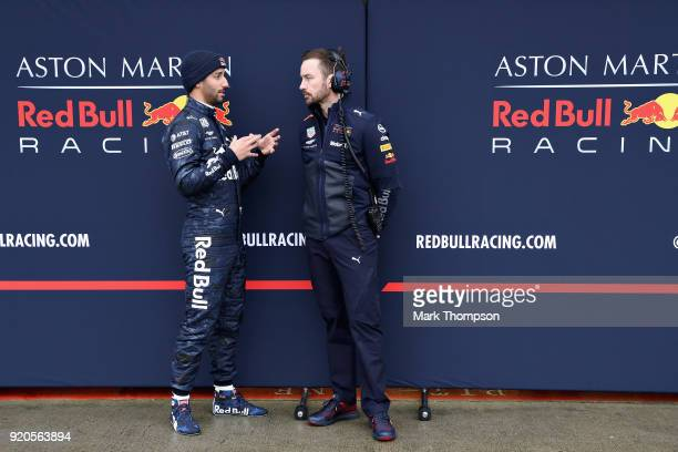Daniel Ricciardo of Australia and Aston Martin Red Bull Racing talks with race engineer Simon Rennie outside the garage during the Aston Martin Red...