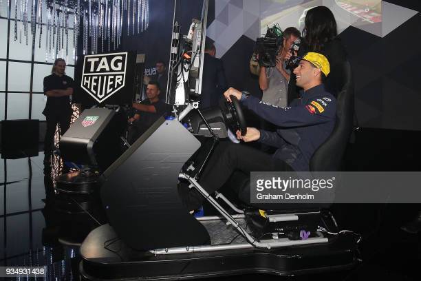 Daniel Ricciardo of Australia and Fabian Coulthard take part in a Gran Turismo activation at the TAG Heuer Australia Grand Prix Party at Luminare on...