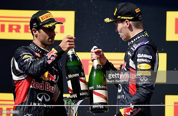 Daniel Ricciardo of Australia and Infiniti Red Bull Racing and Daniil Kvyat of Russia and Infiniti Red Bull Racing celebrate on the podium after...