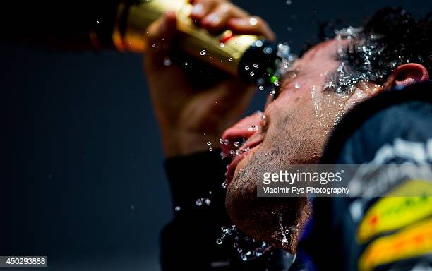 Daniel Ricciardo of Australia and Infiniti Red Bull Racing celebrates on the podium with champagne after winning the Canadian Formula One Grand Prix...