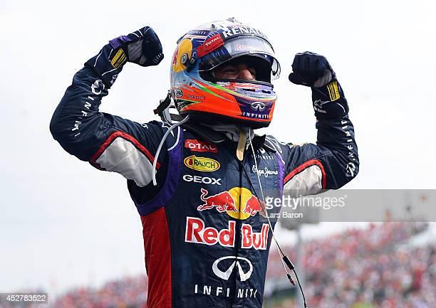 Daniel Ricciardo of Australia and Infiniti Red Bull Racing celebrates victory in the Hungarian Formula One Grand Prix at Hungaroring on July 27 2014...