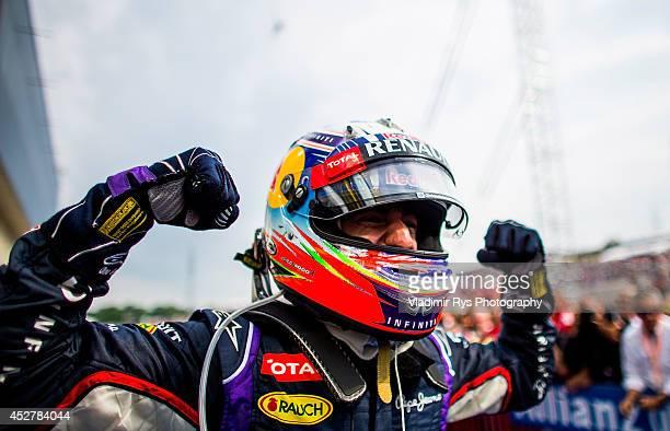 Daniel Ricciardo of Australia and Infiniti Red Bull Racing celebrates after winning the Hungarian Formula One Grand Prix at Hungaroring on July 27...