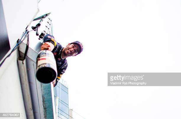 Daniel Ricciardo of Australia and Infiniti Red Bull Racing celebrates on the podium after winning the Hungarian Formula One Grand Prix at Hungaroring...