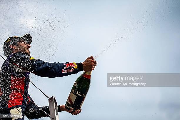 Daniel Ricciardo of Australia and Infiniti Red Bull Racing celebrates on the podium after winning the Hungarian Formula One Grand Prix at Hungaroring...