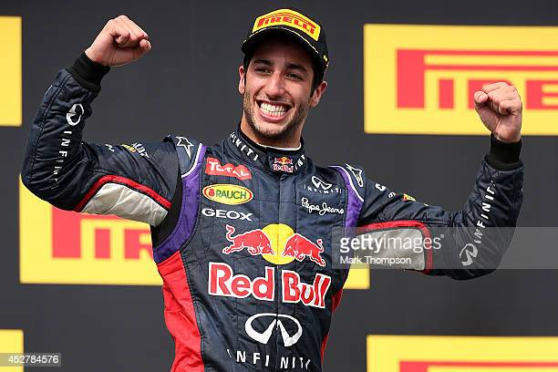 Daniel Ricciardo of Australia and Infiniti Red Bull Racing celebrates victory on the podium after the Hungarian Formula One Grand Prix at Hungaroring...