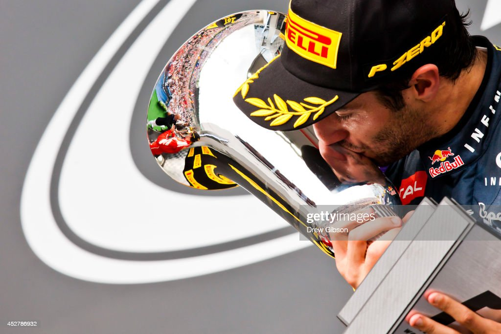 Daniel Ricciardo of Australia and Infiniti Red Bull Racing celebrates victory with the trophy on the podium after the Hungarian Formula One Grand Prix at Hungaroring on July 27, 2014 in Budapest, Hungary.
