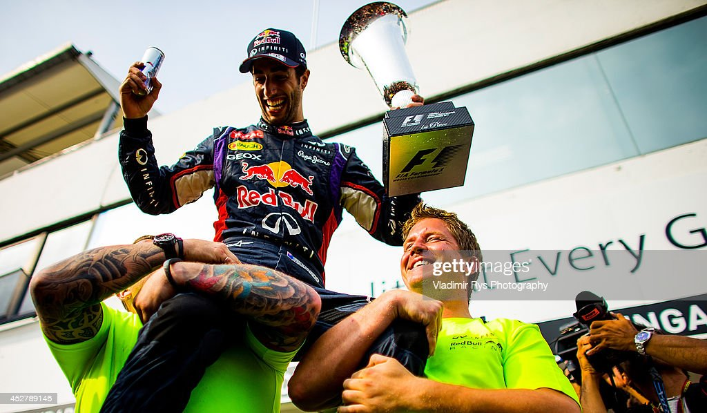 Daniel Ricciardo of Australia and Infiniti Red Bull Racing celebrates with his team after winning the Hungarian Formula One Grand Prix at Hungaroring on July 27, 2014 in Budapest, Hungary.