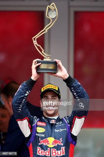 Daniel Ricciardo of Australia and Infiniti Red Bull Racing celebrates his third place during the Monaco Formula One Grand Prix at Circuit de Monaco...