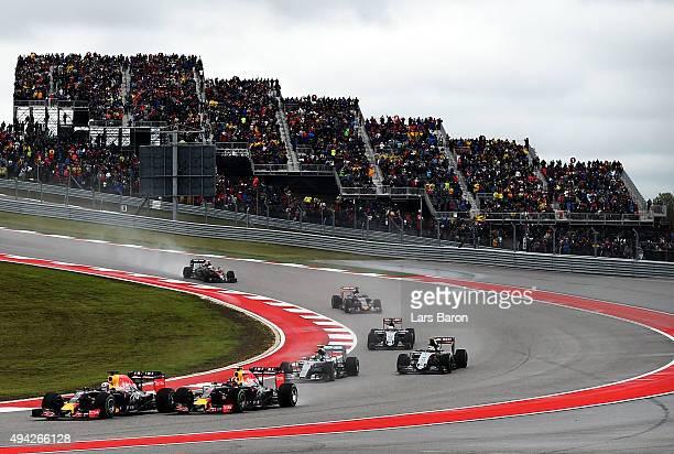 Daniel Ricciardo of Australia and Infiniti Red Bull Racing drives ahead of Daniil Kvyat of Russia and Infiniti Red Bull Racing during the United...