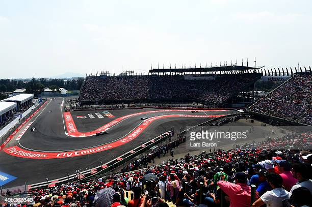 Daniel Ricciardo of Australia and Infiniti Red Bull Racing drives ahead of Valtteri Bottas of Finland and Williams during the Formula One Grand Prix...